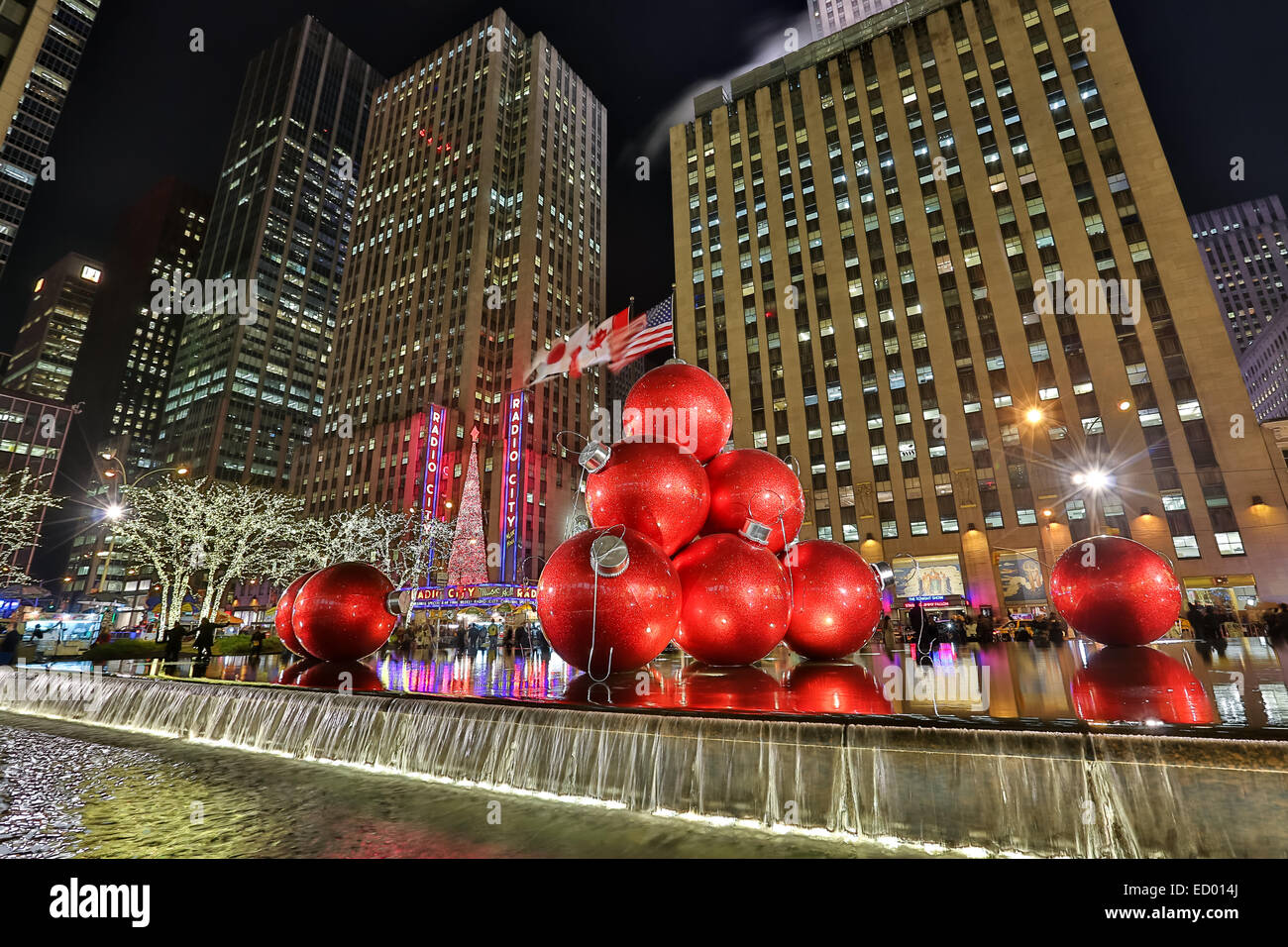 christmas decorations in front of the exxon building across from radio city music hall december 15