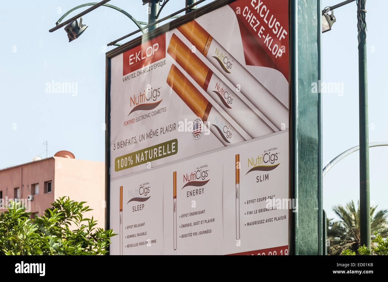 Advertisement hoarding for NutriCigs, an e-cigarette by International Vapour Group marketed by e-Klop in Morocco. - Stock Image