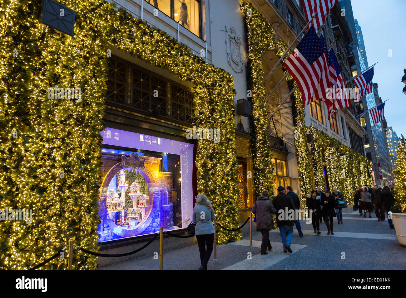 Tourists view the Christmas window holiday display at Lord & Taylor ...
