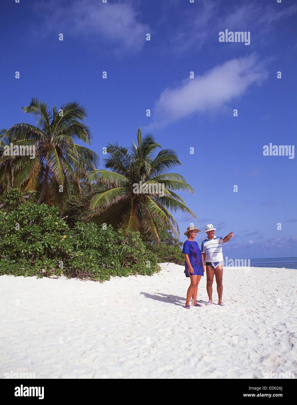 Older couple on beach, Île aux Cerfs Island, Flacq District, Republic of Mauritius - Stock Image