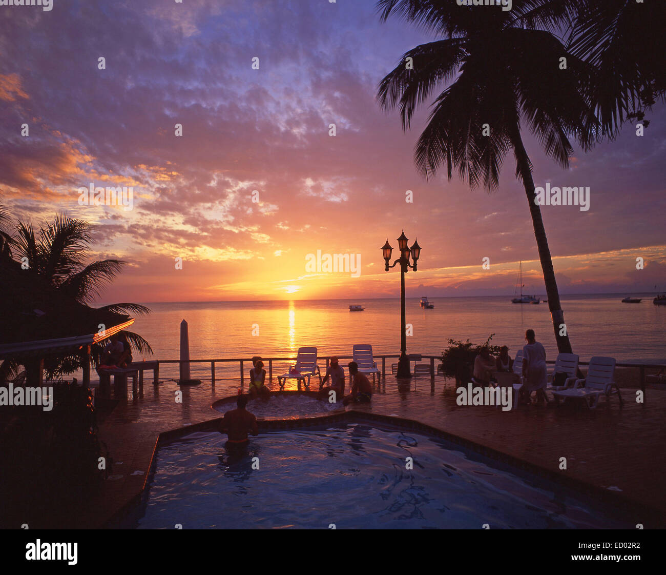 Swimming pool at sunset, Couples Negril Resort, Negril Beach, Negril, Westmoreland Parish, Jamaica, Greater Antilles, Stock Photo