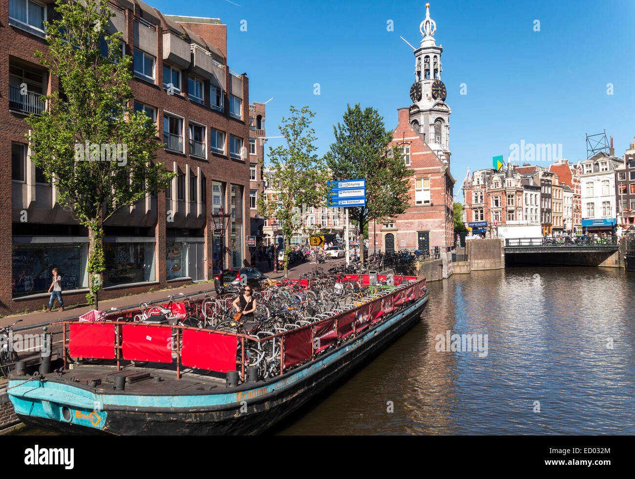 Amsterdam Singel Canal and Muntplein Square with Mint Tower. Barge for parking bicycles of visitors to the flower - Stock Image