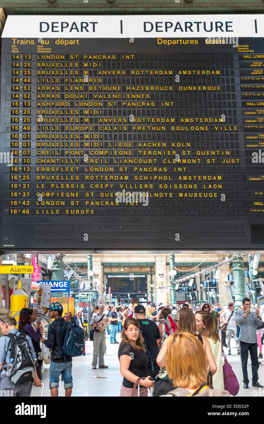 Paris Gare du Nord Station with travelers under train departure board with Paris to London Eurostar schedule time - Stock Image