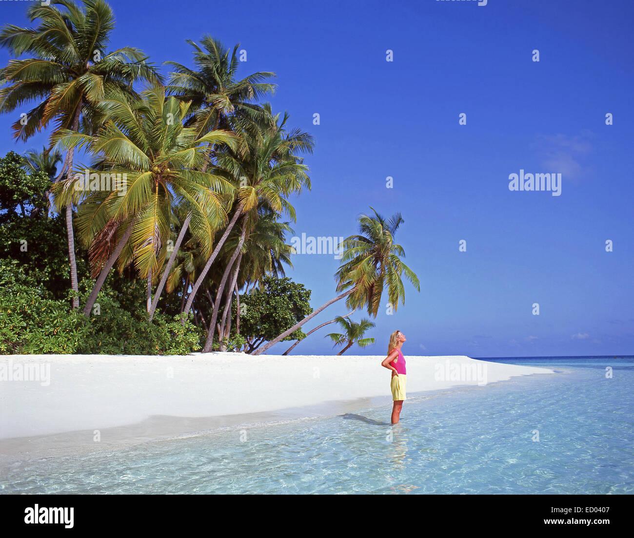 Young woman on tropical beach, Kuda Bandos Island, Kaafu Atoll, Republic of Maldives Stock Photo
