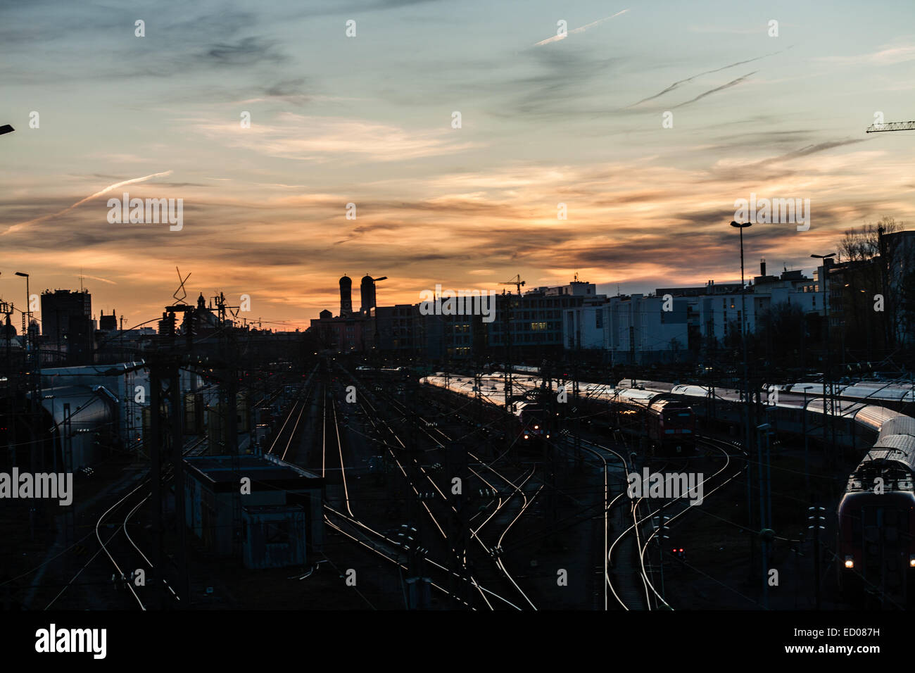 Munich, Germany. Unusually warm weather in Munich, Bavaria this winter. Beautiful sunrise as clouds disperse for - Stock Image