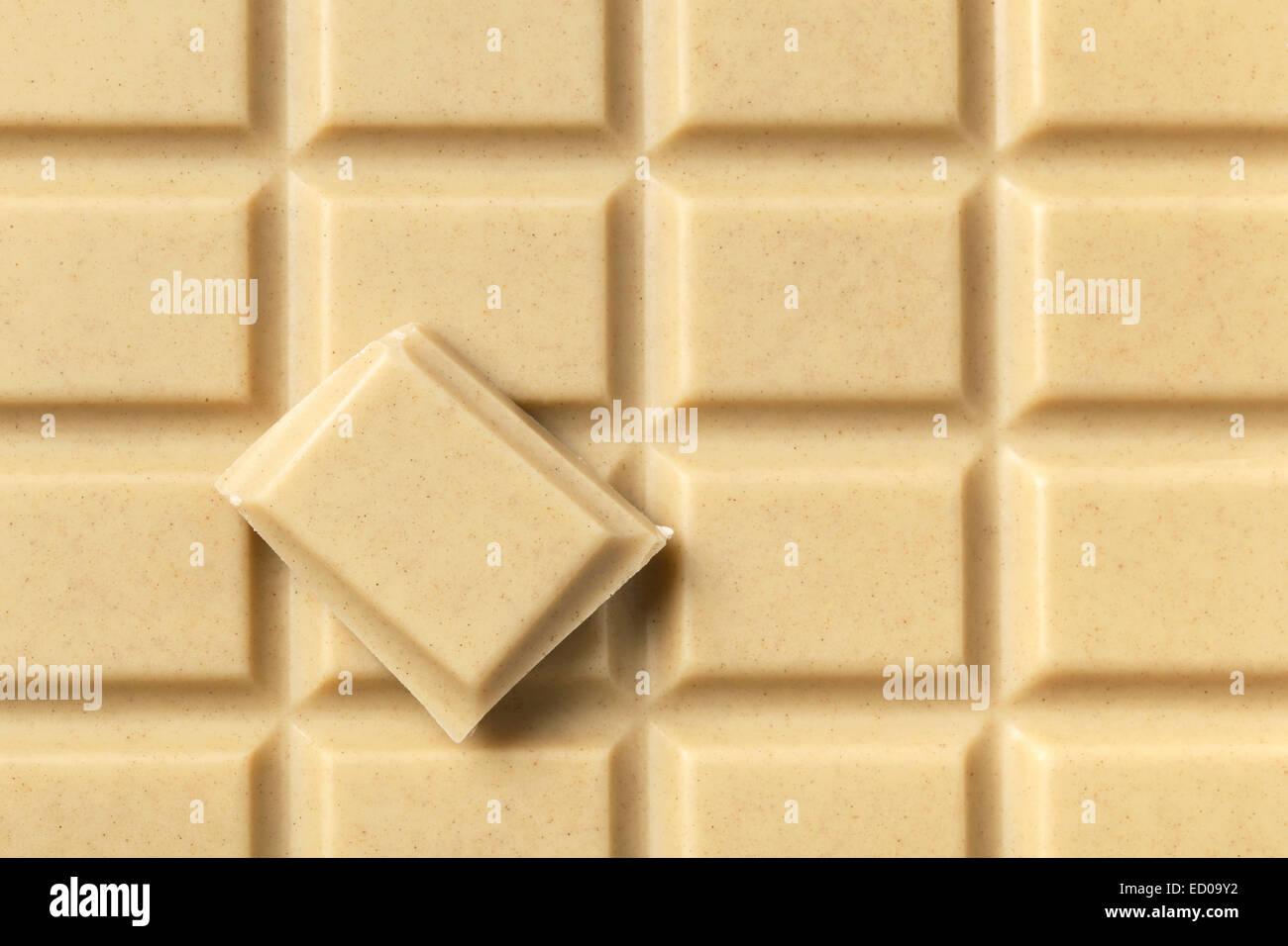 Block of white milky chocolate and single piece. - Stock Image