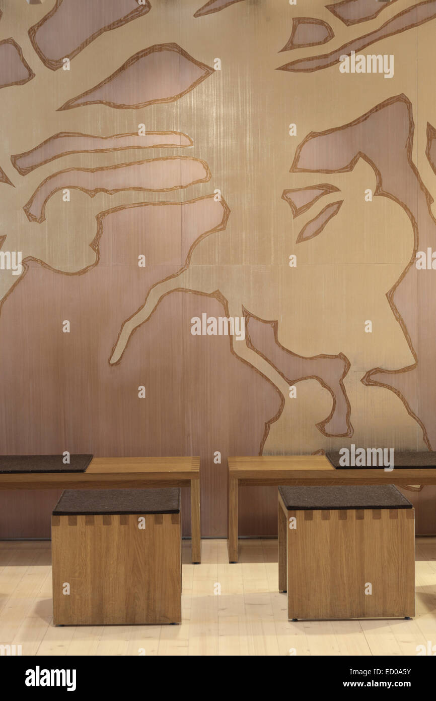 Viikki Church, Helsinki, Finland. Architect: JKMM Architects, 2005. Detail of seating and mural in foyer. - Stock Image