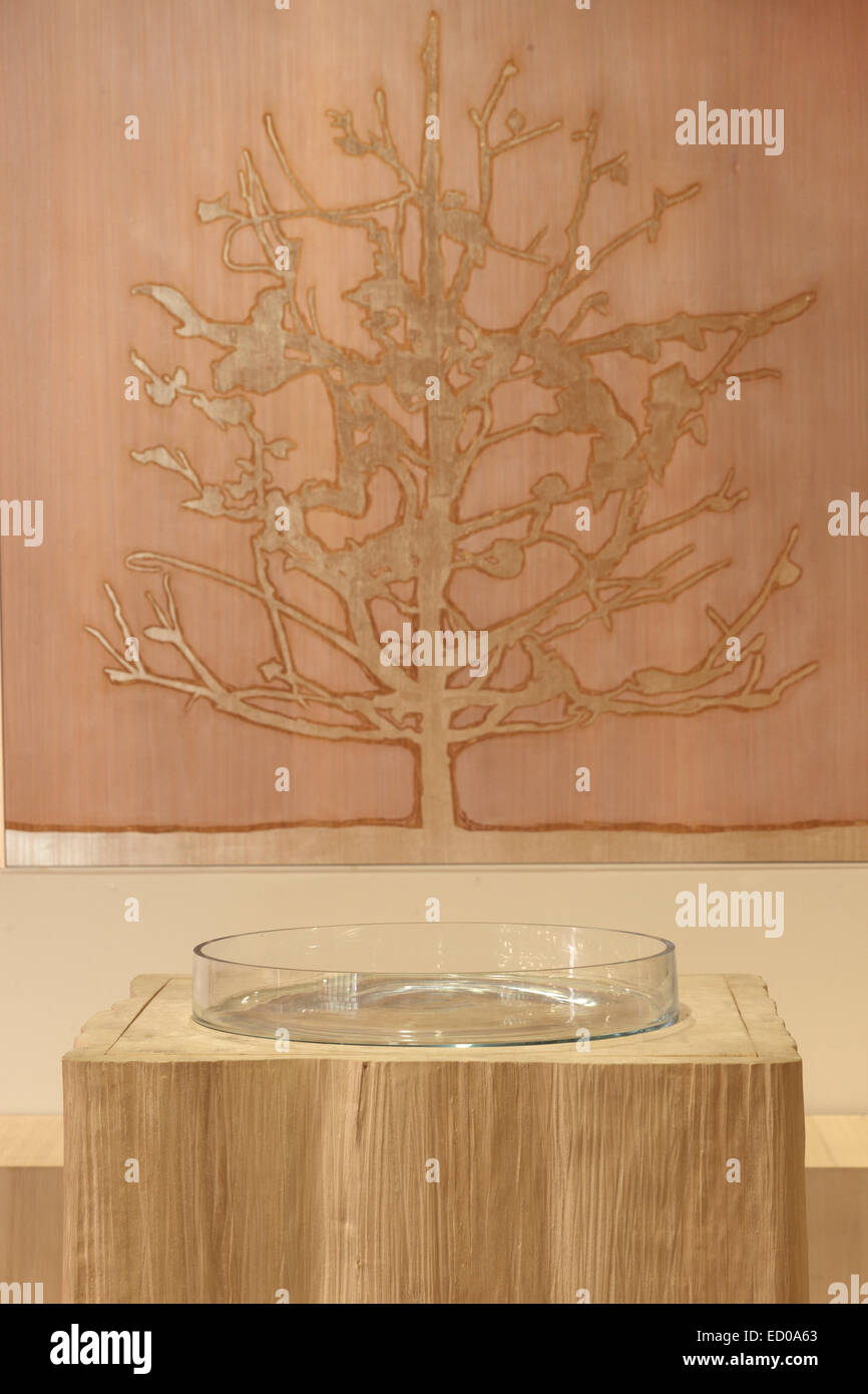 Viikki Church, Helsinki, Finland. Architect: JKMM Architects, 2005. Font and tree mural in baptism recess. - Stock Image