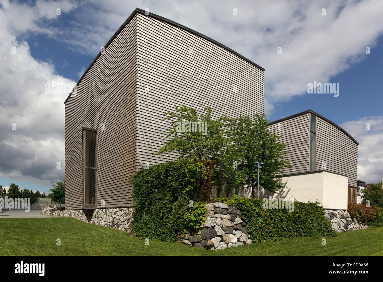 Viikki Church, Helsinki, Finland. Architect: JKMM Architects, 2005. Exterior, with weathered aspen cladding, seen - Stock Image