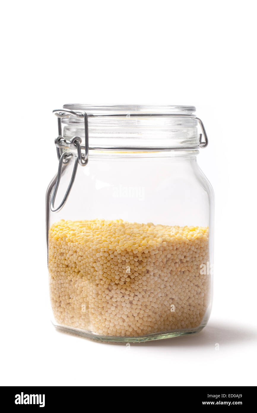Photo of couscous into a jar isolated on white. - Stock Image