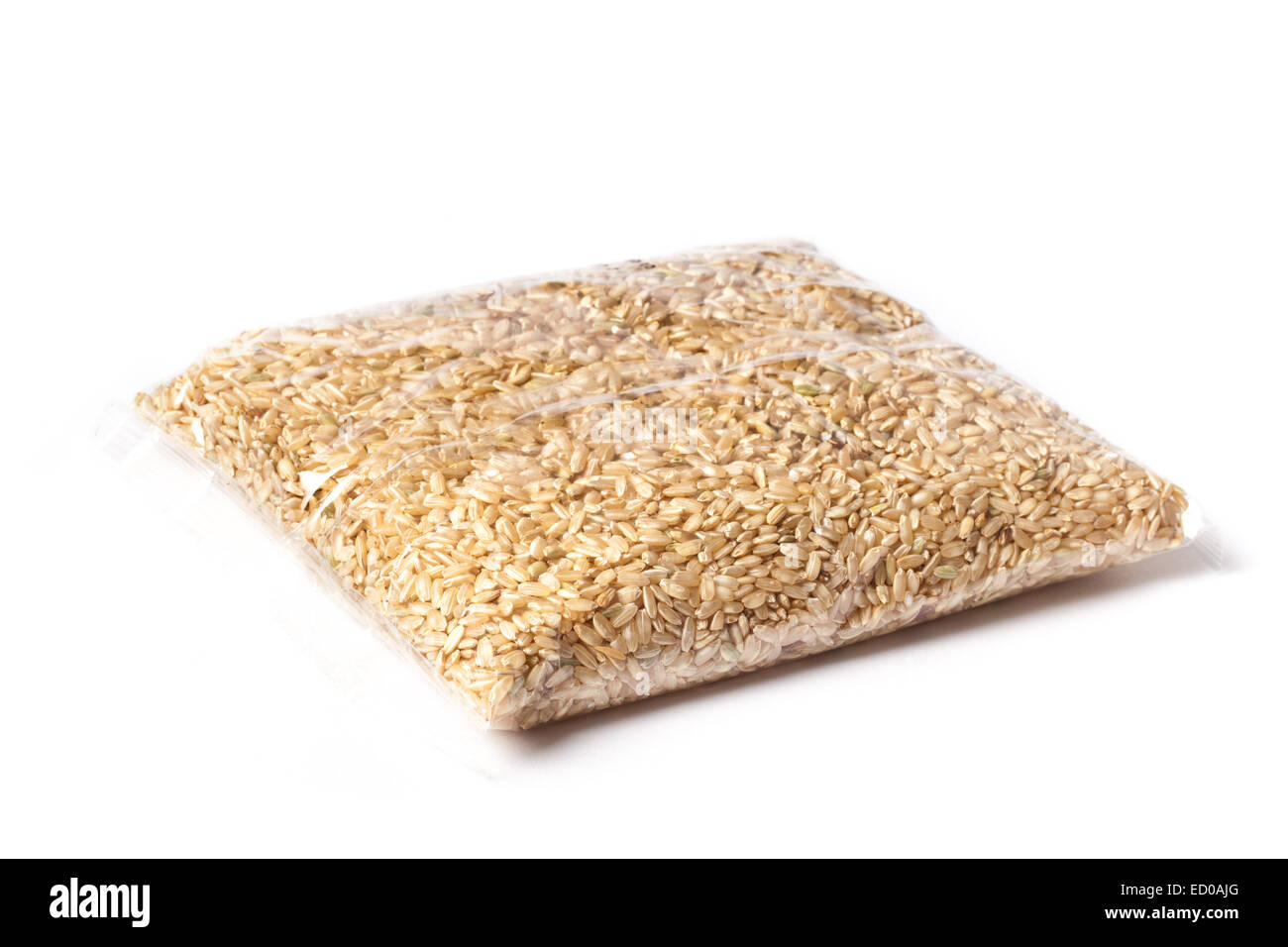 One kilo brown rice in a package. - Stock Image