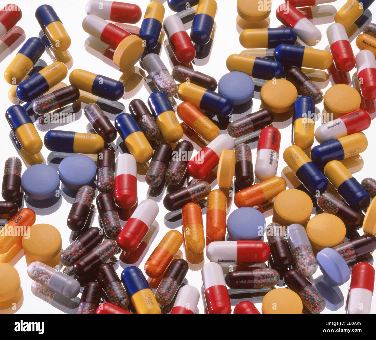 Assorted Pills capsules and tablets on glass background - Stock Image