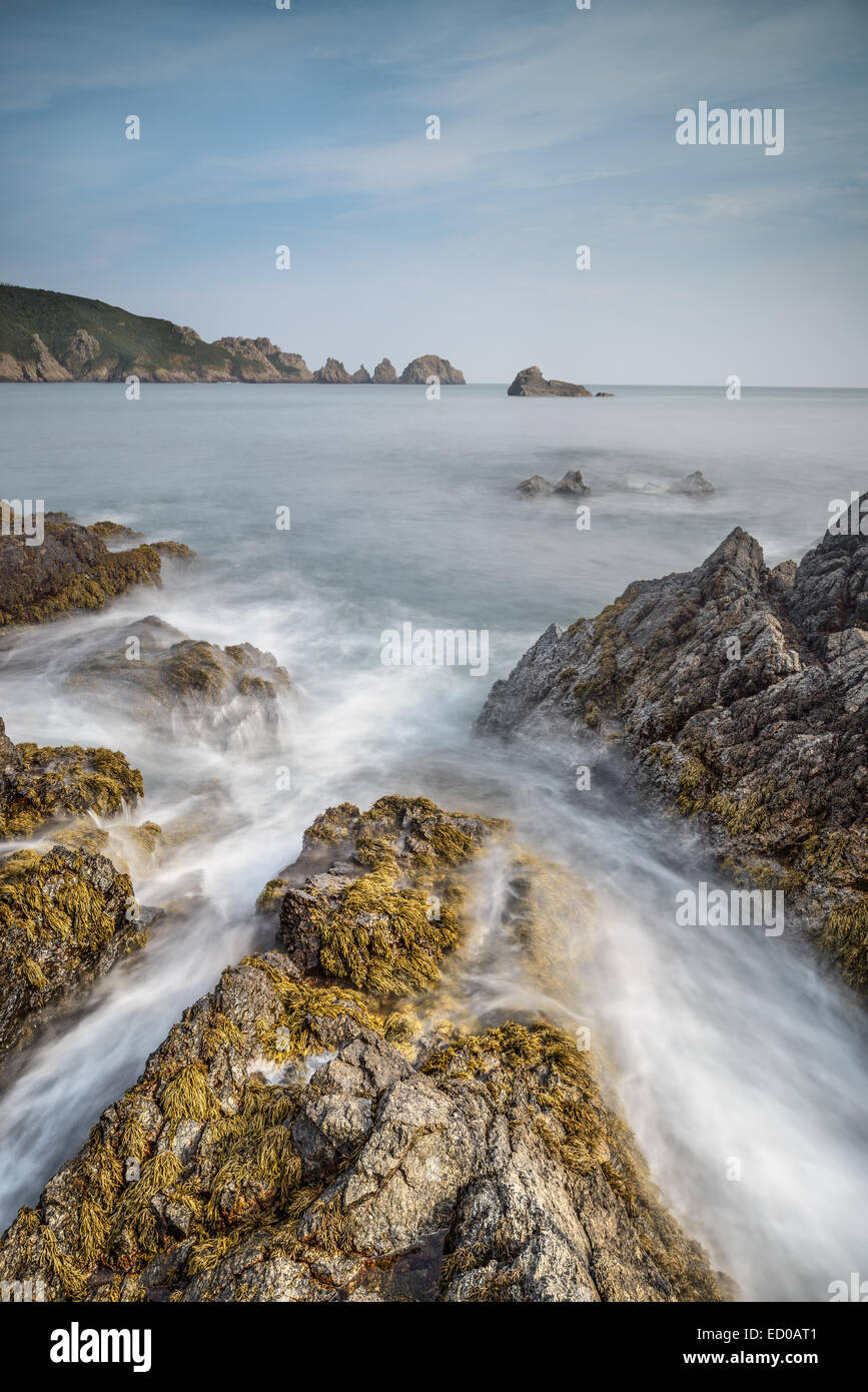 Looking to the Pea Stacks, from Moulin Heut showing waves breaking over reef. - Stock Image