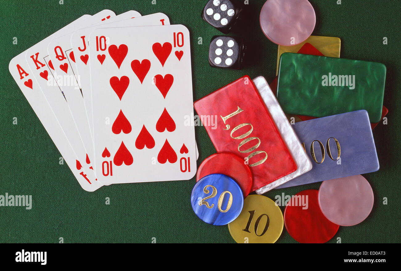 Gambling table with cards, dice and chips. - Stock Image