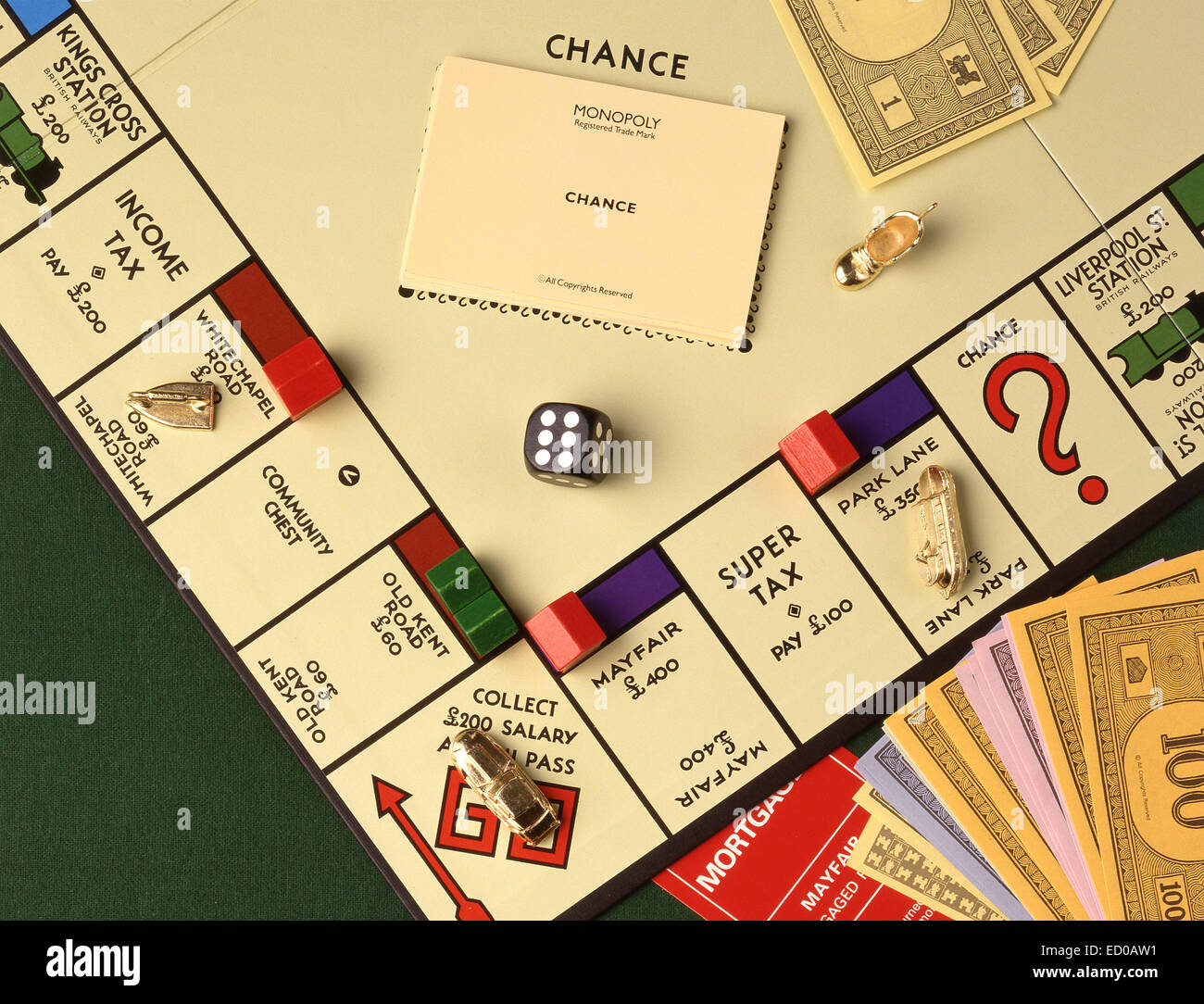 Monopoly board game with money, notes, counters and dice in studio setting - Stock Image