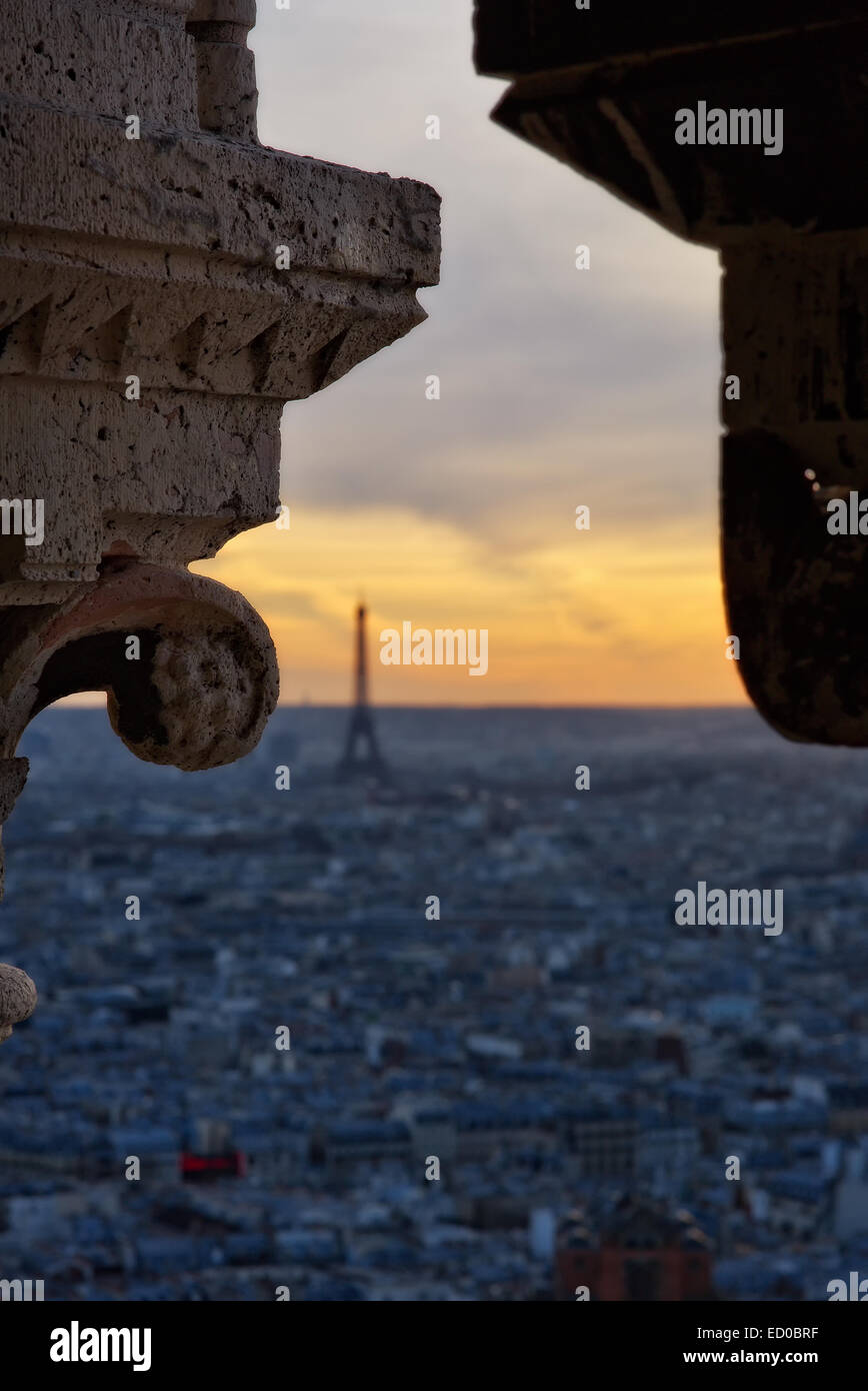 France, Paris, Cornice against cityscape at sunset - Stock Image