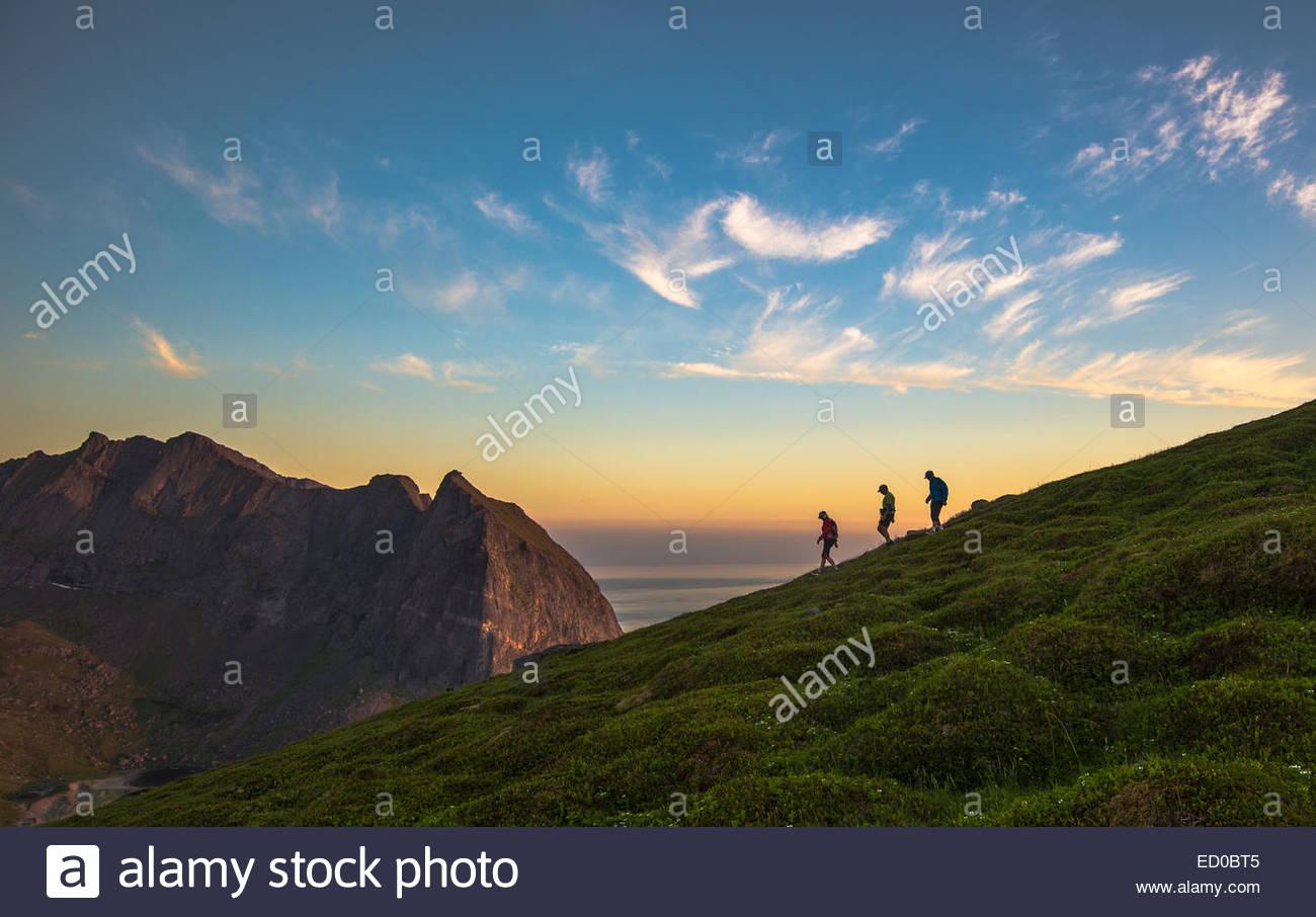 Norway, Flakstad Island, Tourist hiking on Mt Ryten - Stock Image