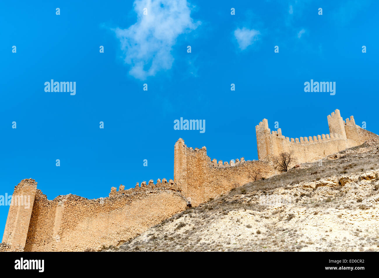 Spain, Aragon, Teruel Province, Albarracin, Fortified wall against blue sky - Stock Image