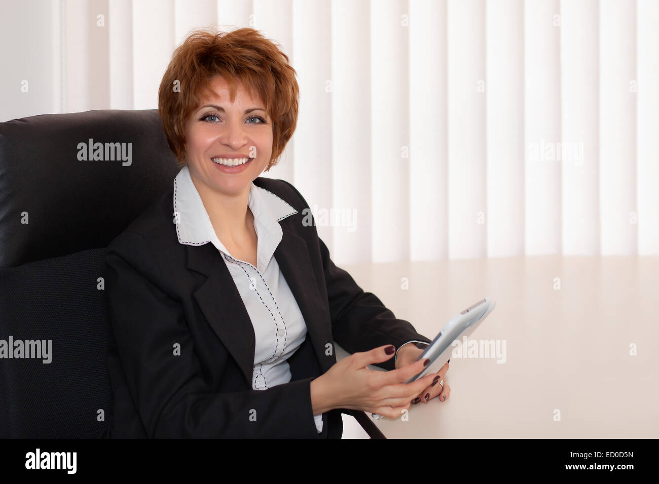Bulgaria, Sofia, Portrait of business woman in office - Stock Image