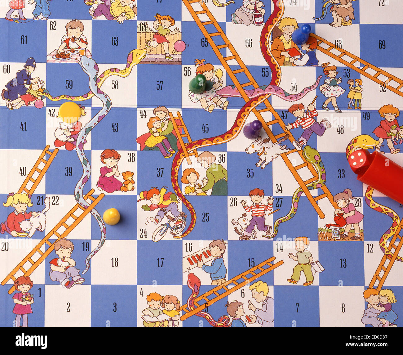 Snakes & Ladders board game with dice and counters (still-life) - Stock Image