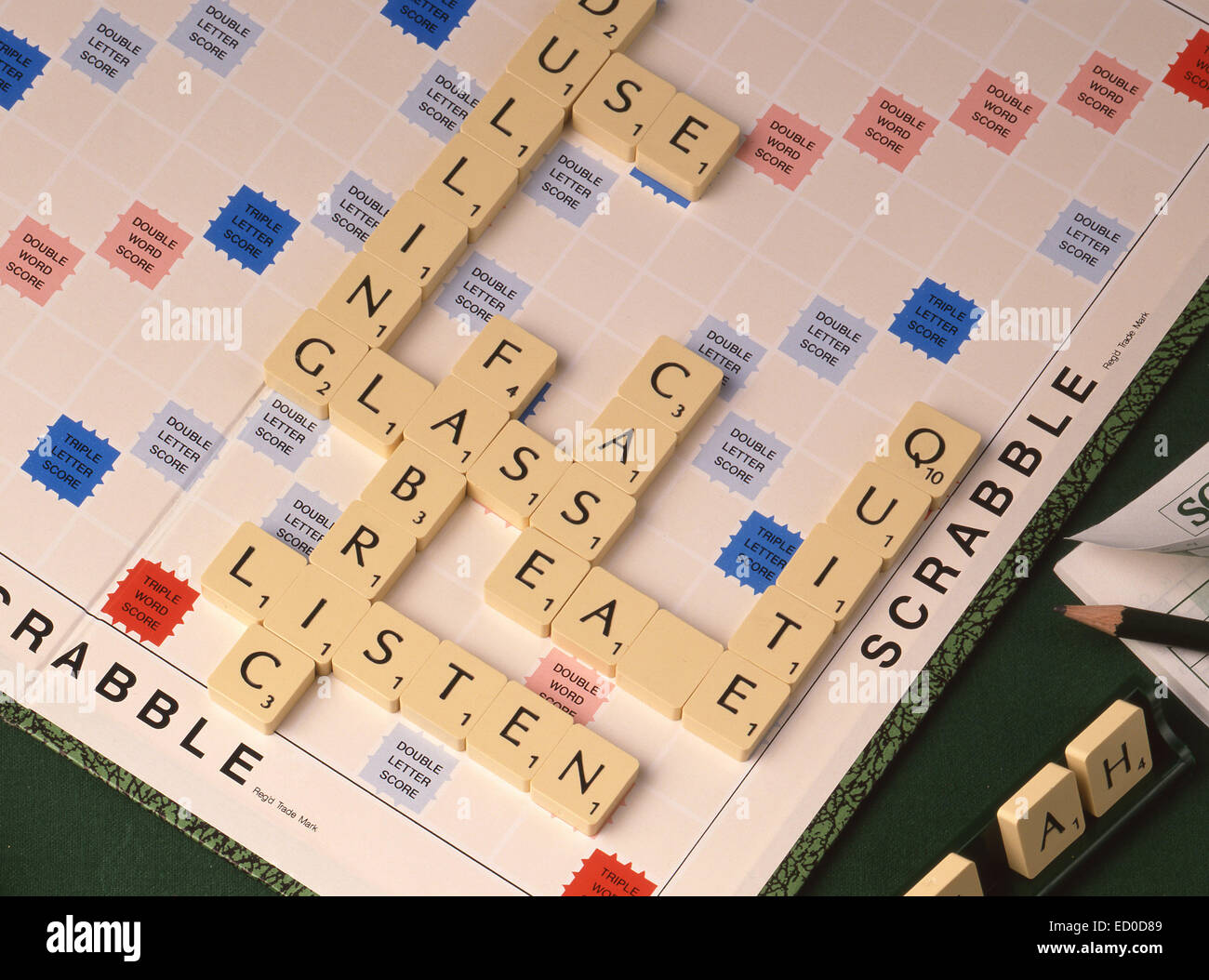 Scrabble board game with tiled letters and pad (still-life) - Stock Image