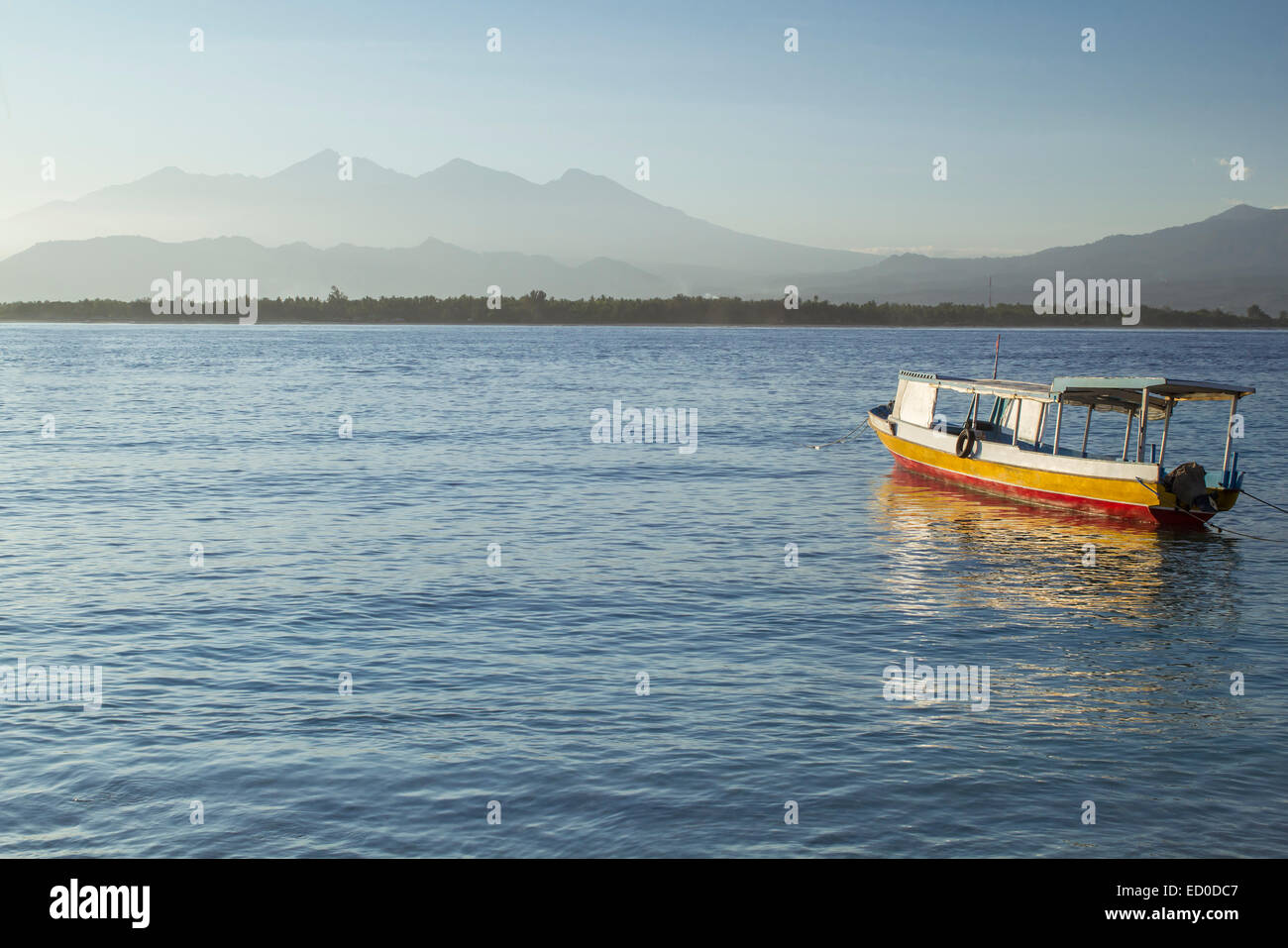 Boat anchored at sea, Mount Rinjani, West Nusa Tenggara, Indonesia Stock Photo