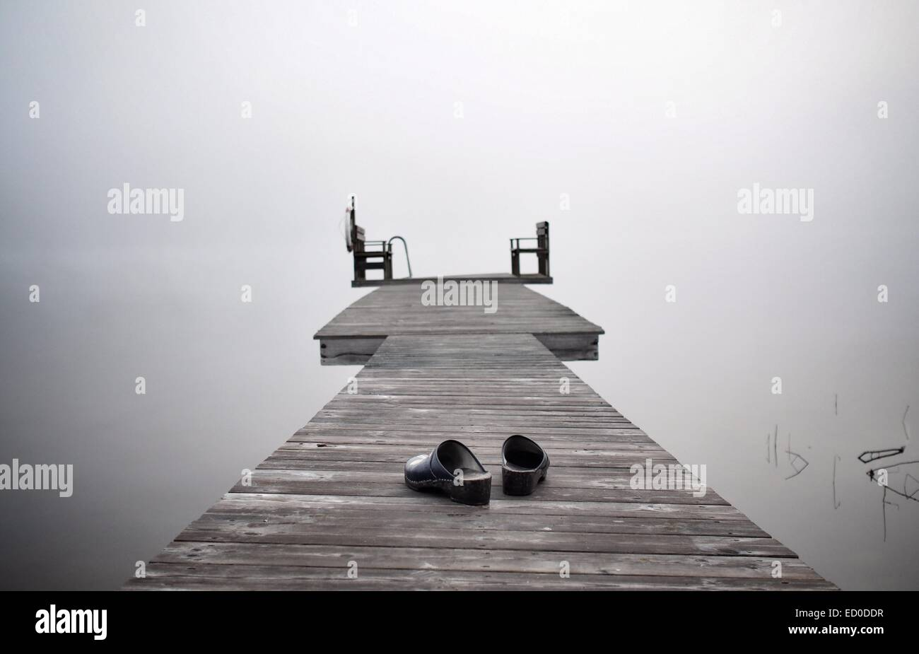 Sweden, Dalarna, View of shoes on wooden pier - Stock Image
