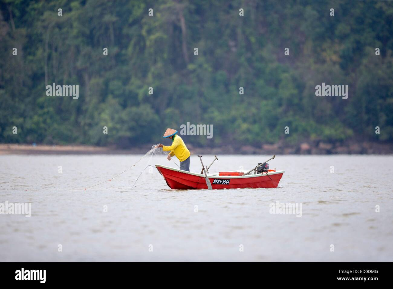 Malaysia, Sarawak state, Kuching, fisherman at the mouth of the river Salak in the South China Sea Stock Photo