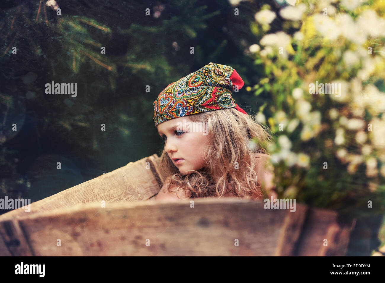 Portrait of girl (4-5) in traditional headscarf - Stock Image