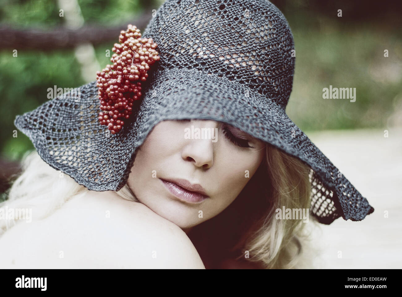 Portrait of woman in lace hat - Stock Image