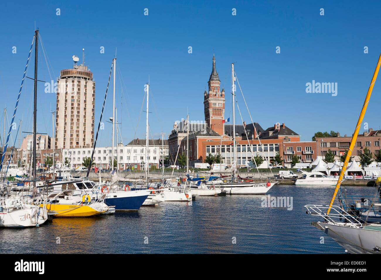 France, Nord, Dunkirk, boats in the marina and city hall belfry listed as World Heritage by UNESCO Stock Photo