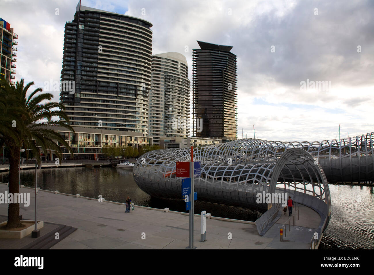 The sculptural and aesthetically pleasing Webb Bridge crossing the Yarra River Docklands Melbourne Victoria Australia - Stock Image