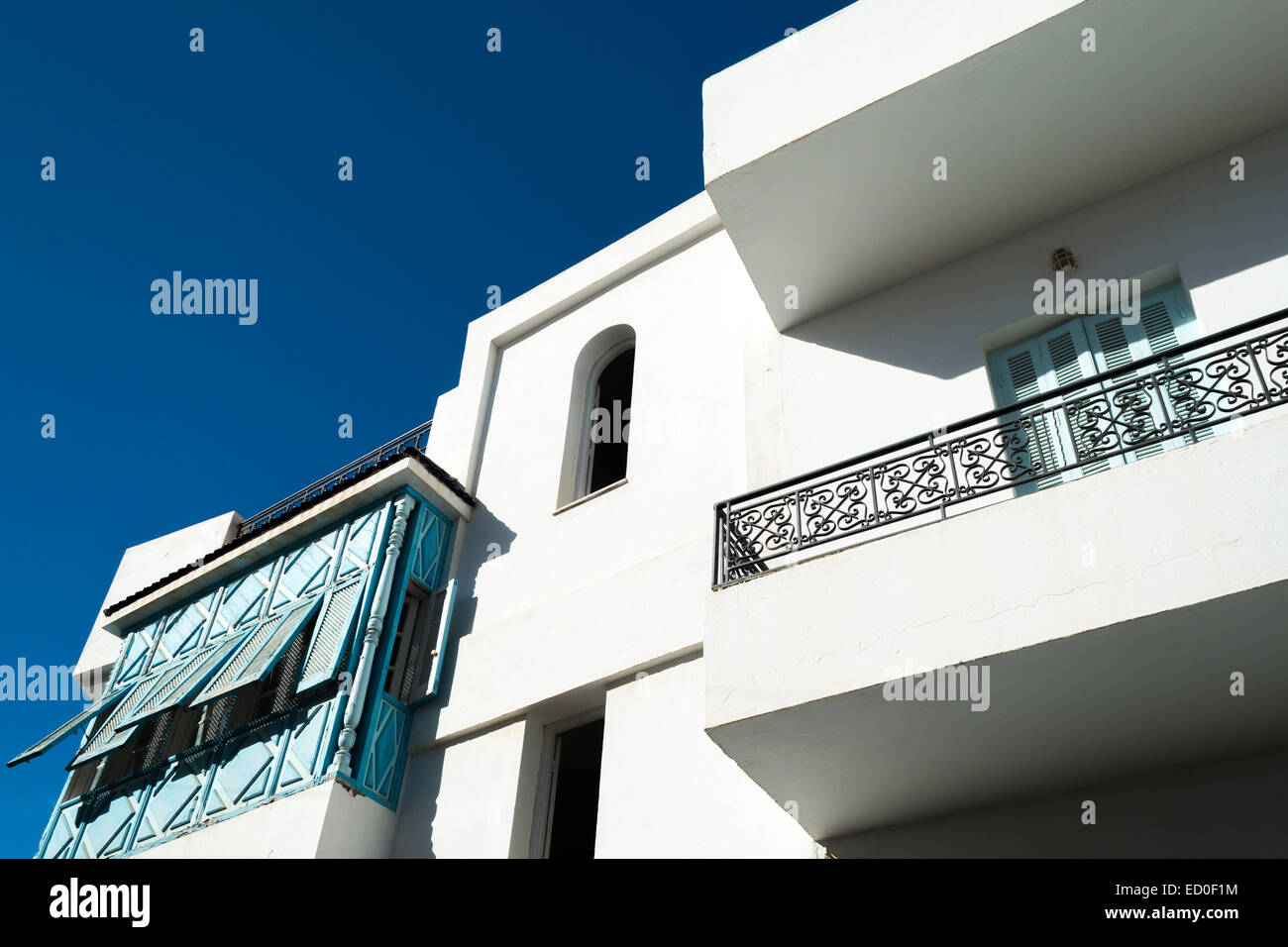 White Tunisian Home with Blue Shutters Stock Photo