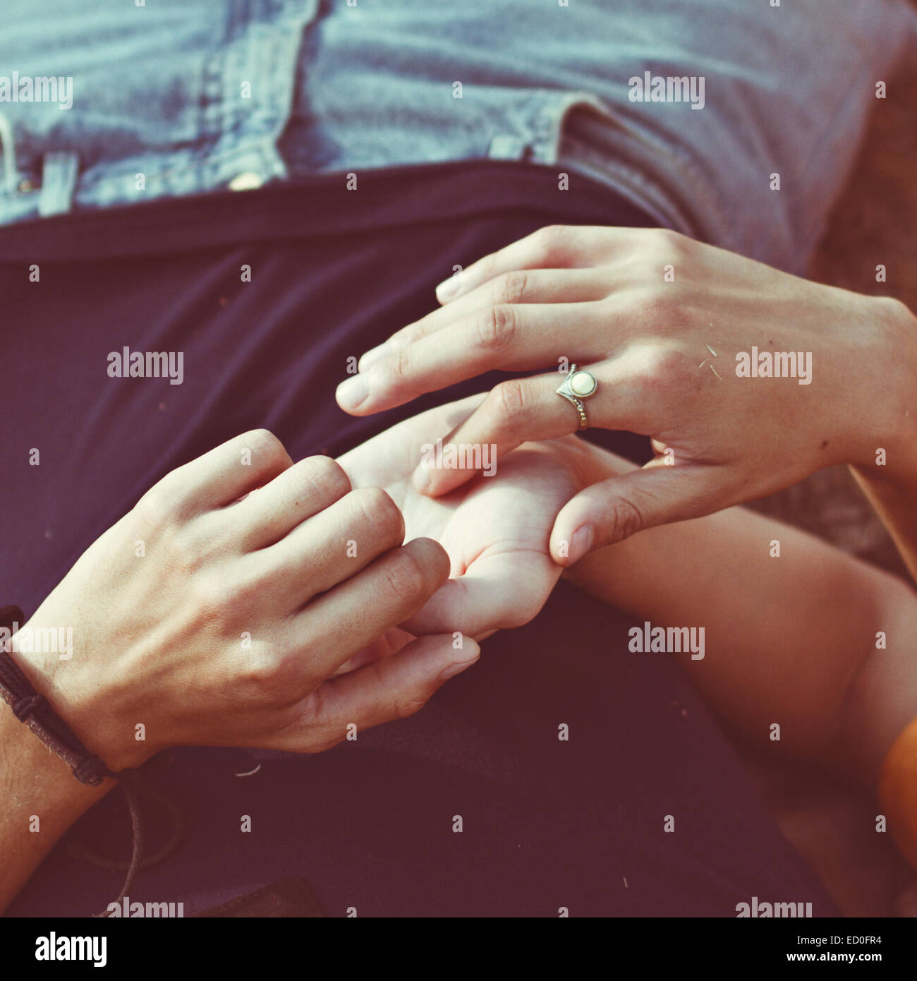 Close-up of woman touching a man's hand - Stock Image