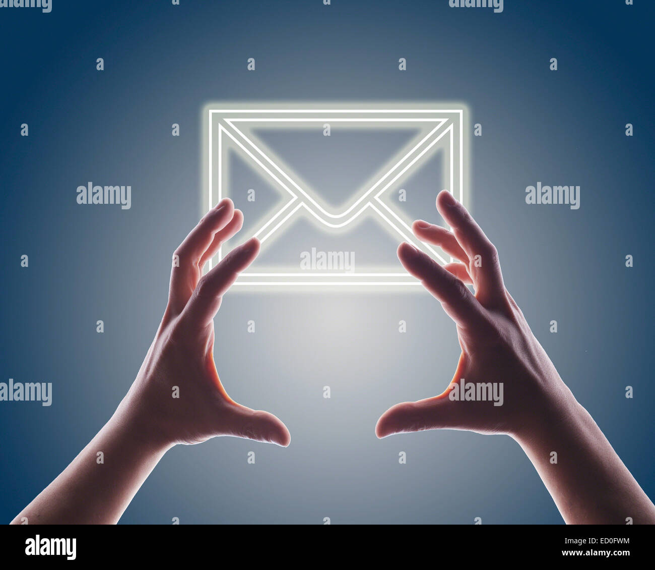 Woman's hands reaching digitally generated image of envelope - Stock Image