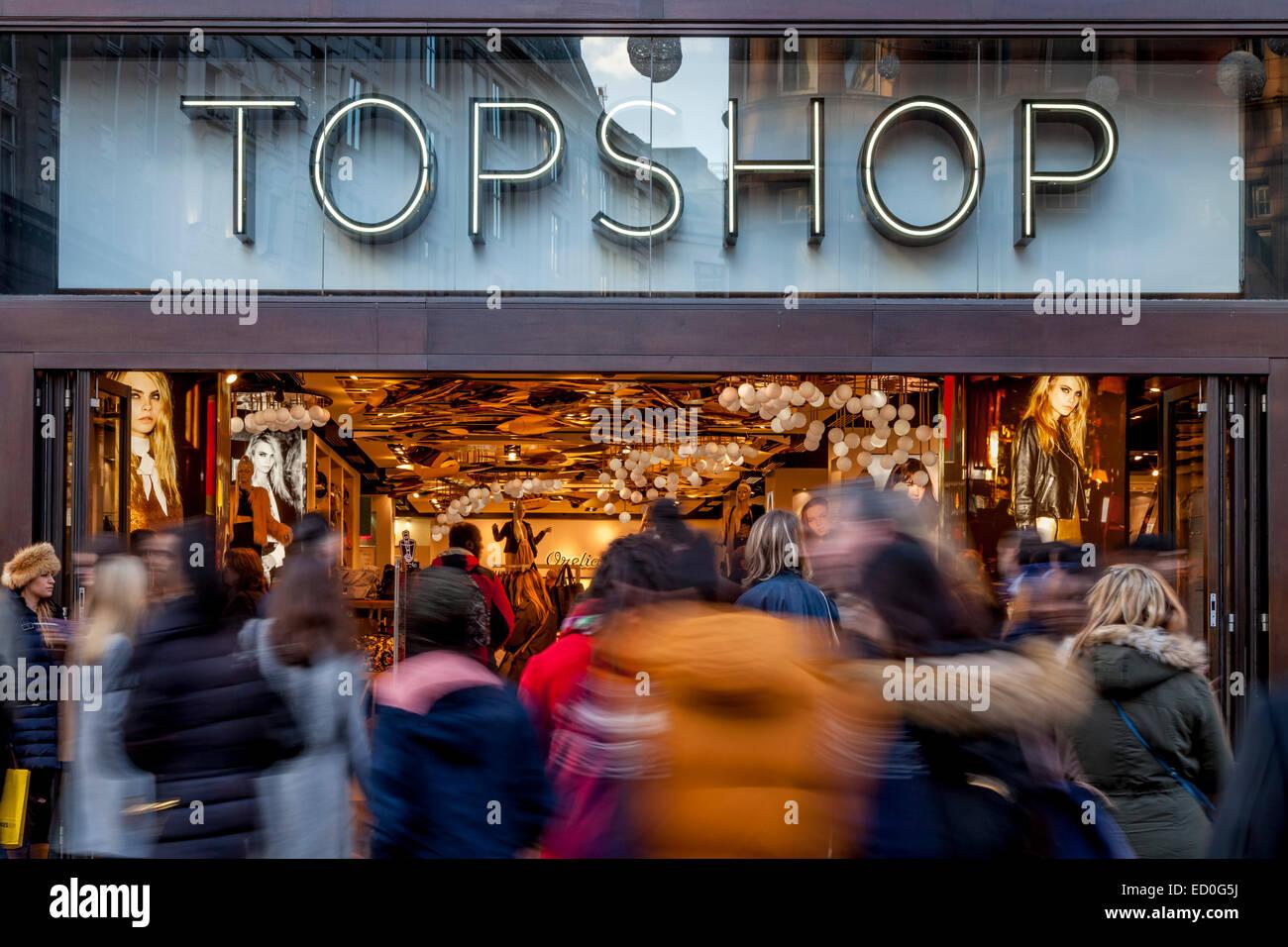 Christmas Shoppers Outside TOPSHOP, Oxford Street, London, England - Stock Image
