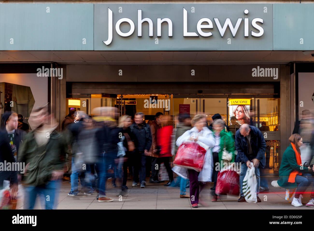 Christmas Shoppers Outside John Lewis, Oxford Street, London, England - Stock Image