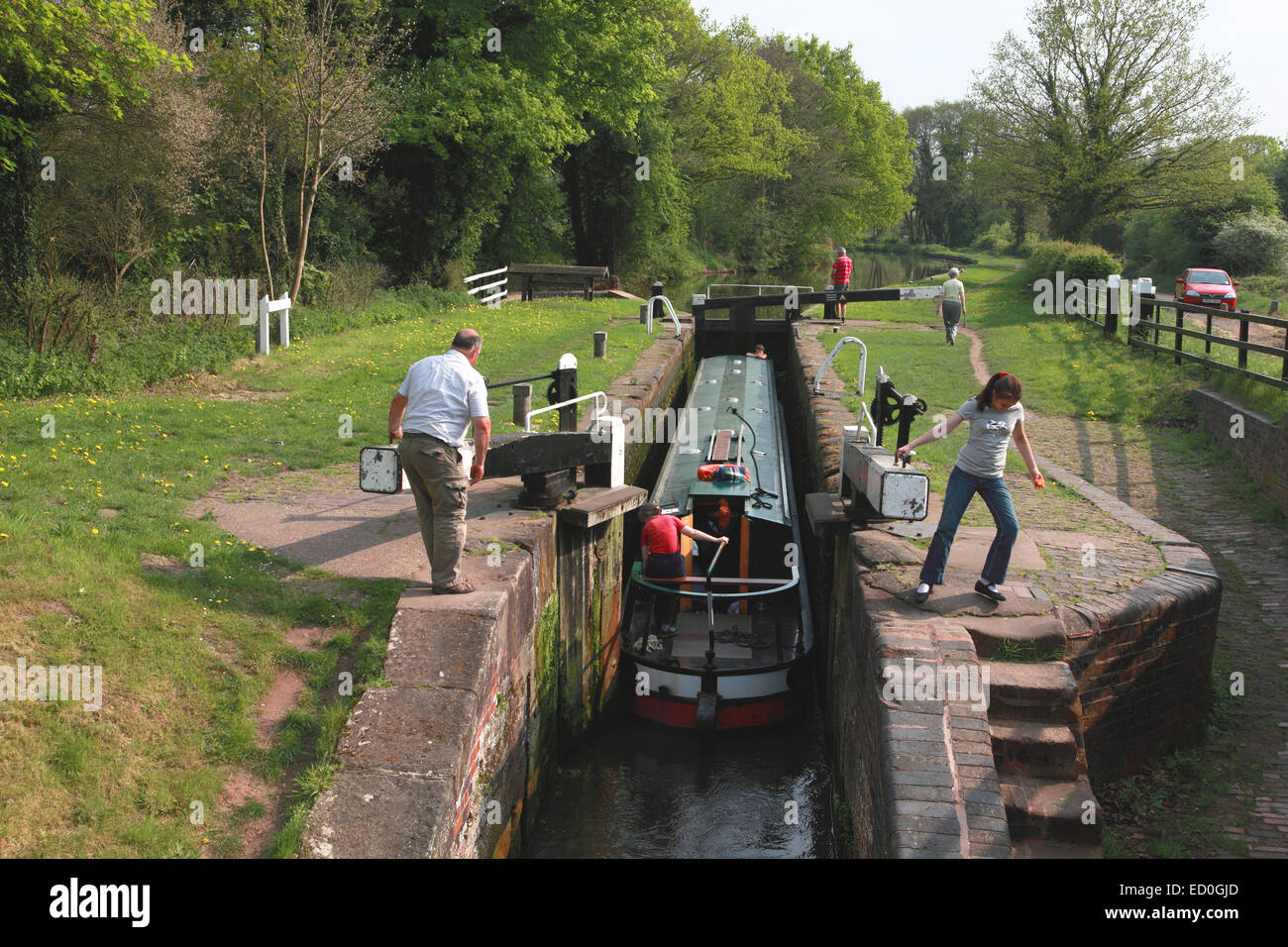 A narrowboat entering Shutt Hill Lock near Acton Trussell on the Staffordshire and Worcestershire Canal Stock Photo