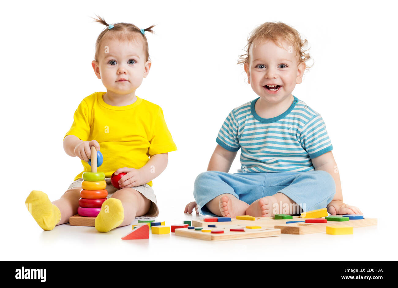 Funny kids playing educational toys isolated - Stock Image