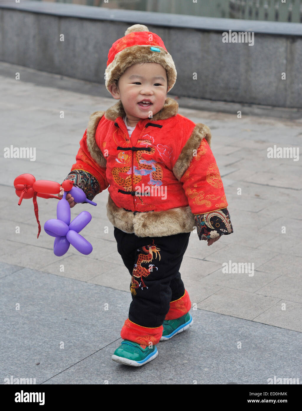 b982fbe1b Cute chinese baby in traditional costume Stock Photo: 76845907 - Alamy