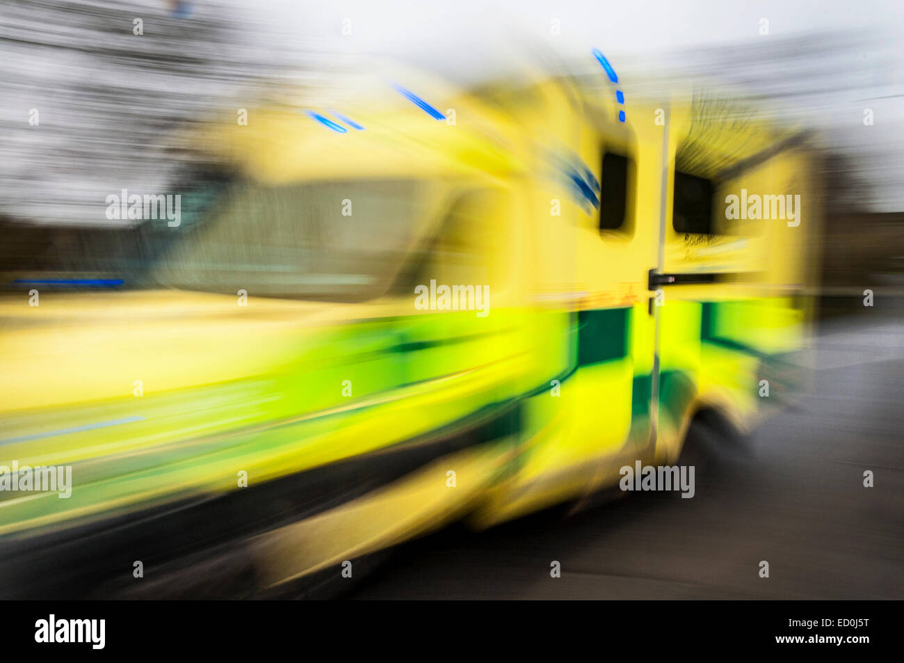 Fast moving ambulance responding to an emergency image showing speed blur. Stock Photo