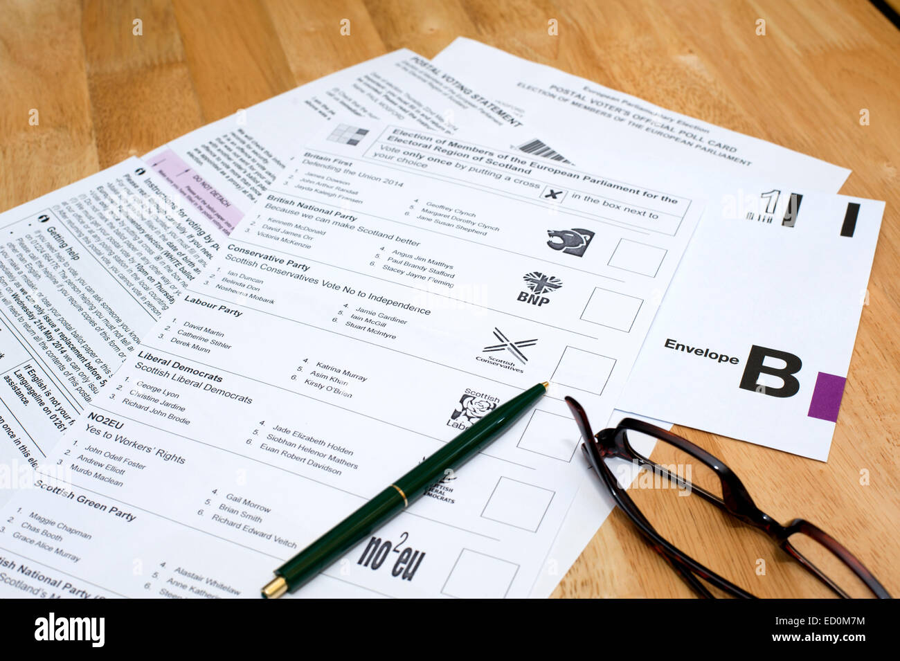 Completing and preparing a postal vote for sending off - Stock Image