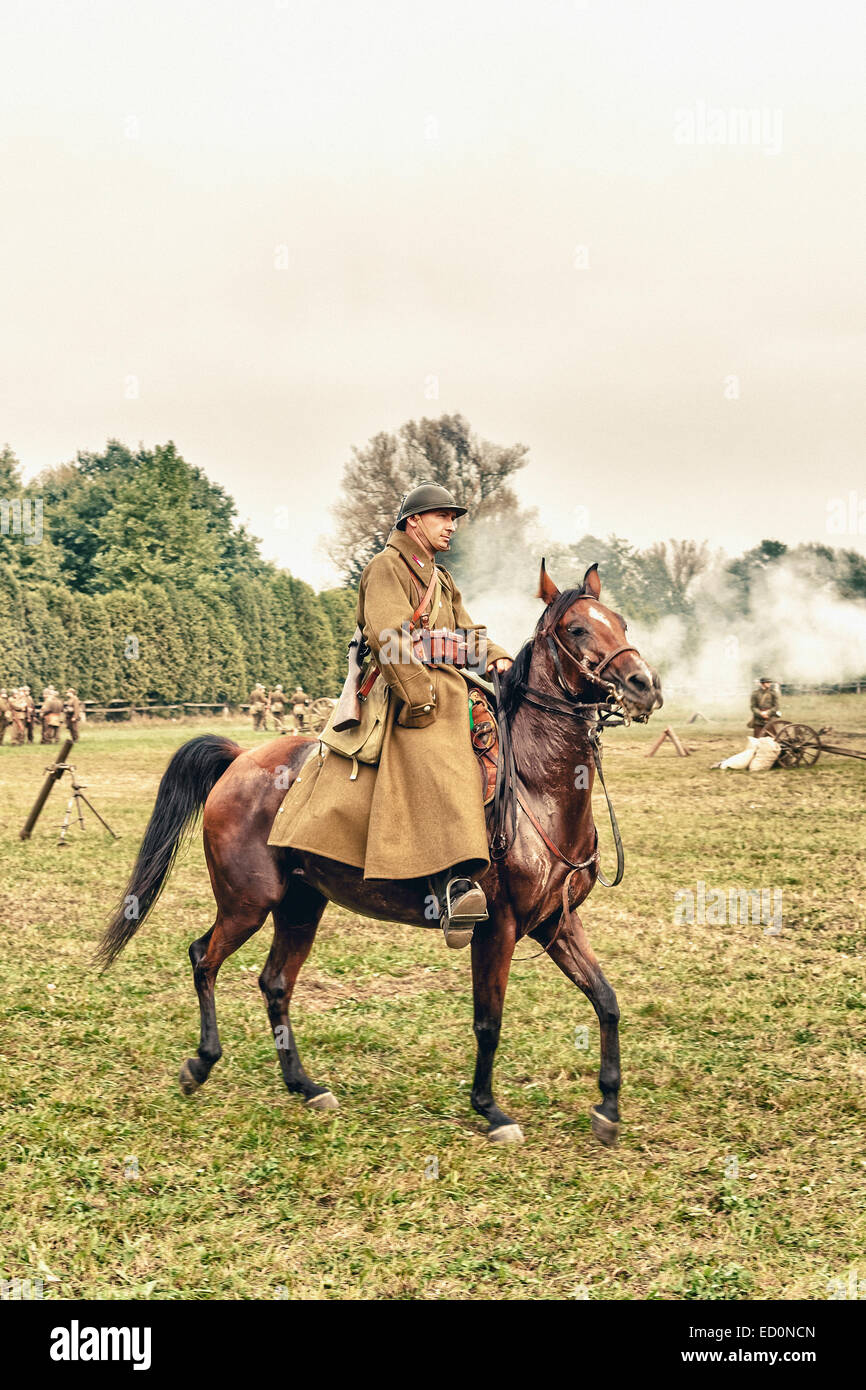 Polish cavalryman ride his horse during WWII Battle of Lomianki - historical reenactment, Poland - Stock Image
