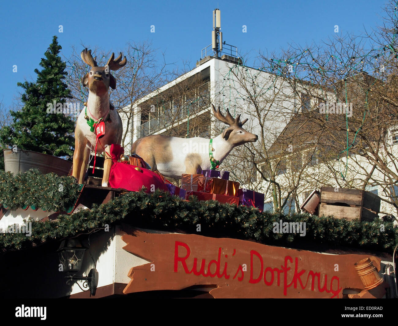 The reindeer and gifts are ready in the Christmas market  (Weihnachtsmarkt) in the Rudolfplatz, Cologne, Germany, - Stock Image