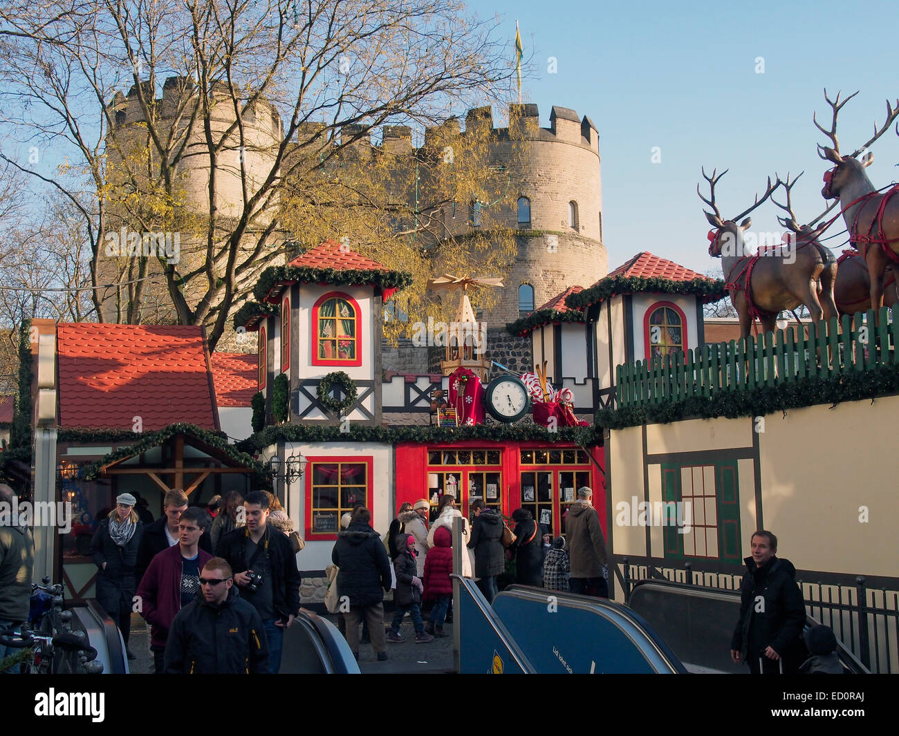Colouful  shops and stalls in the Christmas market  (Weihnachtsmarkt) in the Rudolfplatz in Cologne, Germany, December - Stock Image