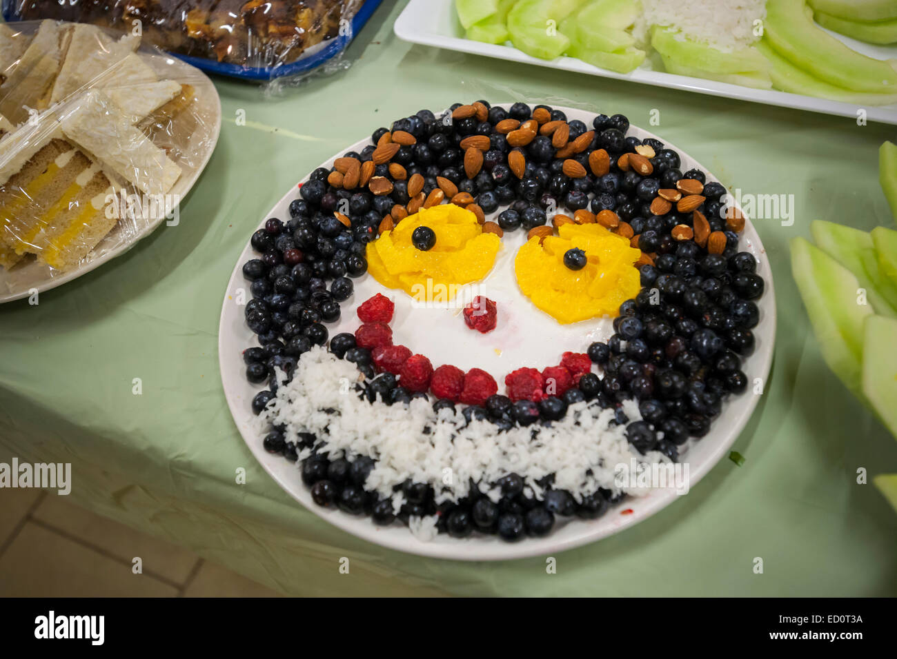 Fruit And Nut Dessert In The Shape Of A Smiley Face In The Upper