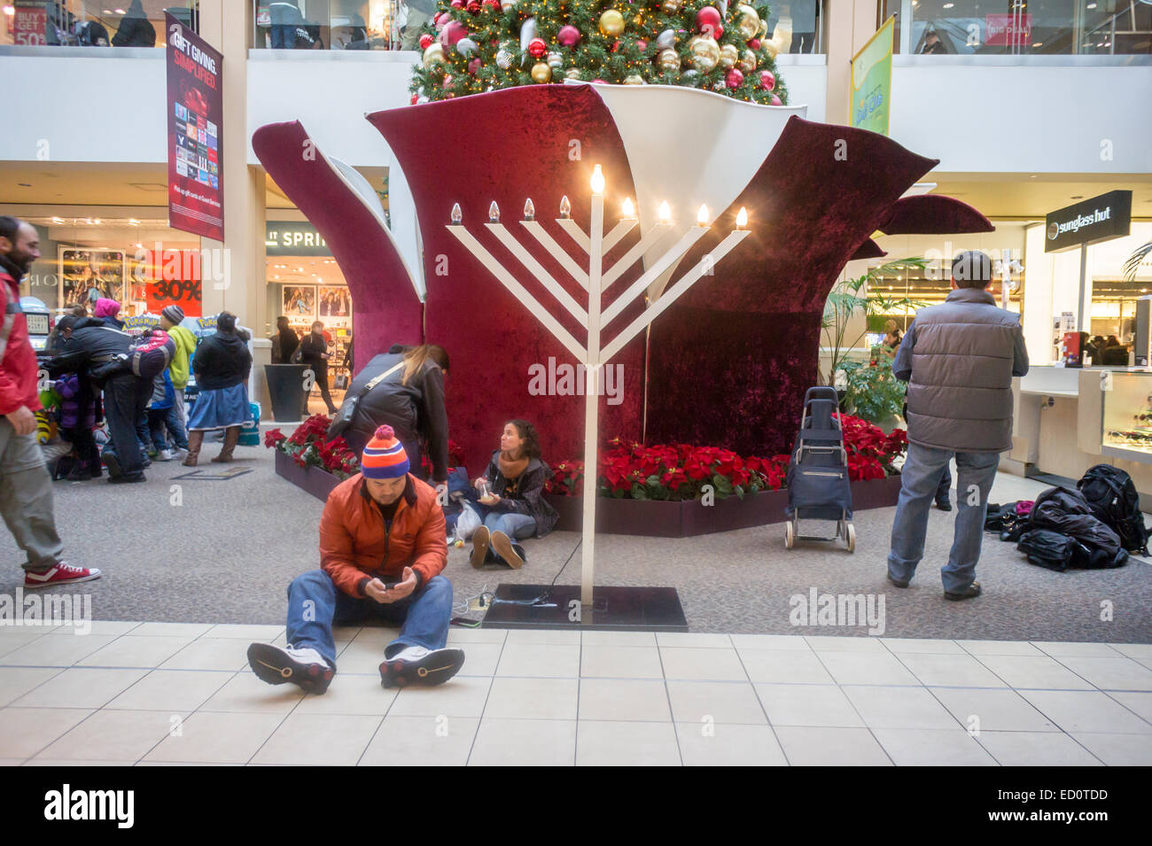 Multicultural holiday display in the Queens Center mall in the borough of Queens in New York on Super Saturday, - Stock Image