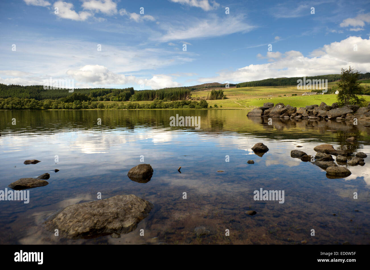 Summer sky reflected in the calm waters of the RSPBs Loch Ruthven in the Highlands of Scotland - Stock Image