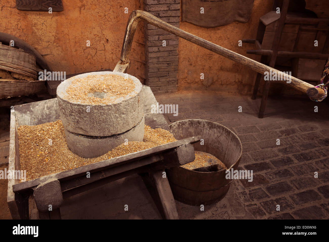 Gristmill ancient stone grain mill at a rural history museum in Zhangjiajie, Hunan, China - Stock Image