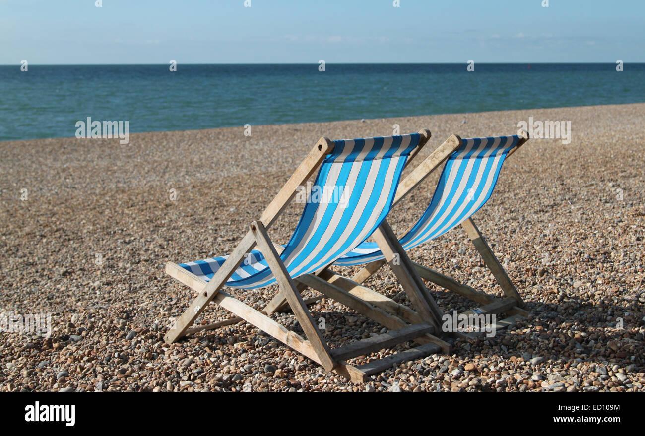 Empty deckchairs on Brighton beach, England, UK Stock Photo